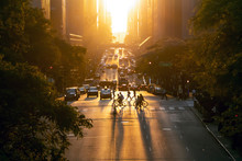 Sunset Over 42nd Street Casts Long Shadows From The People And Cars In Midtown Manhattan, New York City
