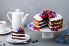 Chocolate Cake With Whipped Cream And Fresh Berries. Grey Stone Background.