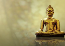 Statue Of Buddha Sitting On Gold Background