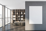 Gray living room with poster and bookcase
