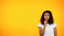Thoughtful Black Woman Touching Chin And Looking Up, Choosing Between Options