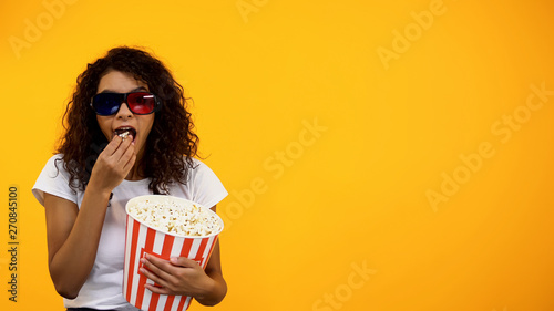 African-American girl in 3d glasses with popcorn watching comedy show, template Fototapeta