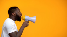 African-American Man Using Megaphone For Protest, Calling To Action, Side View