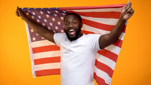 African-American Man Holding US Flag, Independence Day Celebration, Holiday