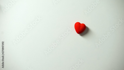 Stampa su Tela  Heart figure on white background, love and charity concept, real feelings