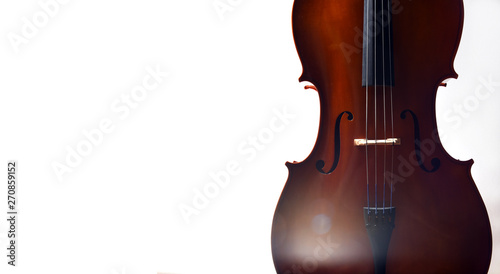 Fotografia Cello in dramatic light with empty space and lens flare