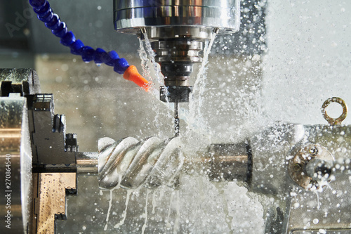 CNC milling machine work. Coolant and lubrication in gear metalwork industry