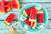 Homemade Watermelon Popsicles On A Plate. Top View On A Rustic Blue Wood Background. Summer Food Concept.