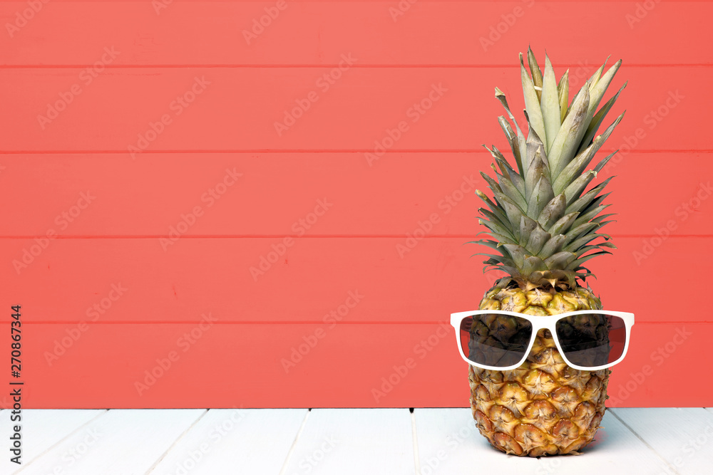 Fototapety, obrazy: Hipster pineapple with sunglasses against a living coral colored wood background. Minimal summer concept.