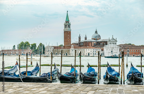 Stickers pour portes Venise Gondolas moored by Saint Mark square with San Giorgio di Maggiore church in Venice, Italy