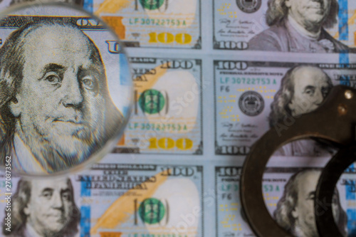 Fotografie, Tablou  Printed US dollars banknotes, fake money currency counterfeiting for magnifying