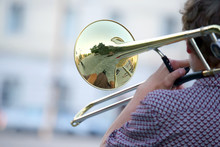Male Musician Plays The Trombone. Music And Creativity. Jazz And Blues.
