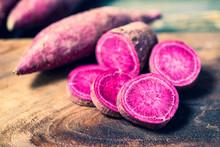 Purple Sweet Potatoes On Wooden Background