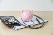 Piggy Bank With Stethoscope  Financial Checkup Or Saving For Medical Insurance Costs