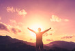 Copy space of man raise hand up on top of mountain and sunset sky abstract background.