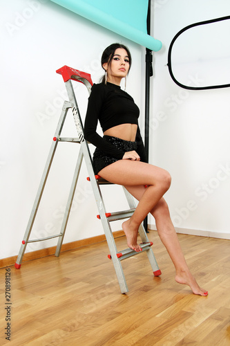 Vászonkép beautiful latin girl in photo studio