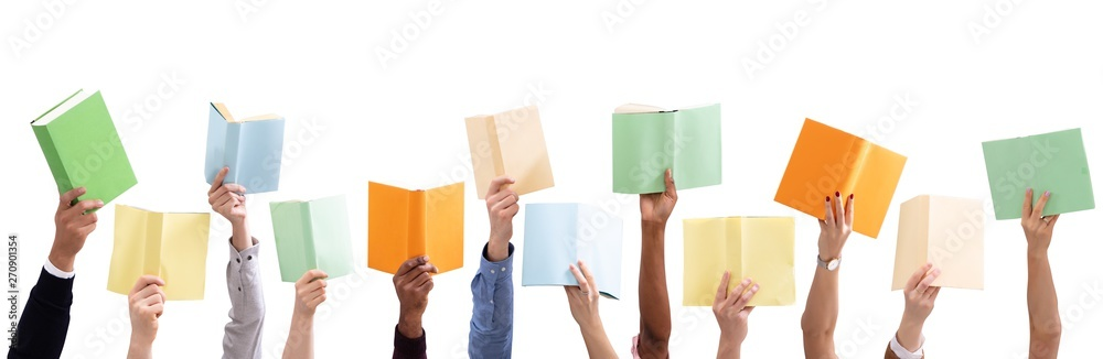 Fototapeta People's Hand Holding Colorful Books Against White Background