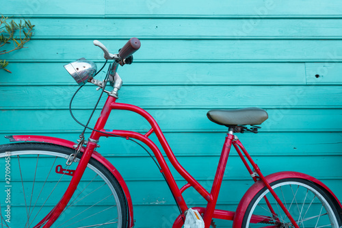 Aluminium Prints Bicycle red vintage bicyle parking on blue wooden wall