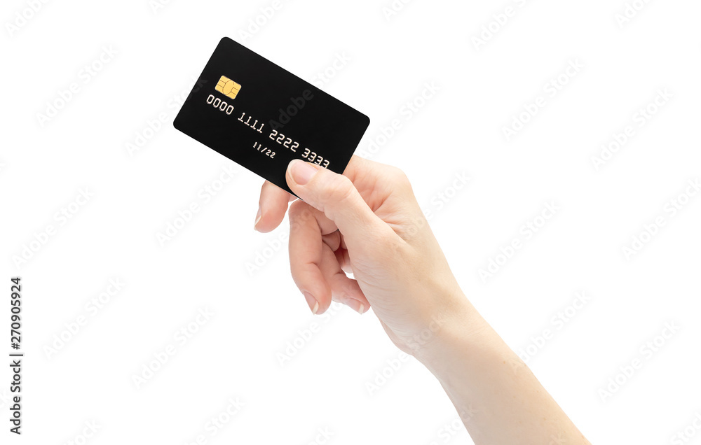 Fototapeta Woman's hand holding credit card. Isolated on white.