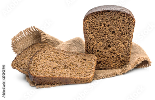 Sliced rye bread on sack napkin. Isolated on white.