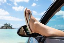 Woman's Feet Wearing Flip-flop Place Out Of Car Window