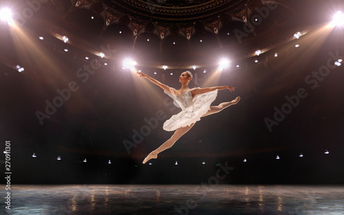 Ballet. Classical ballet performed by a couple of ballet dancers on the stage of the opera house. - 270911301
