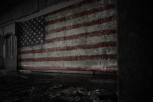 Painted Flag Of United States Of America On The Dirty Old Wall In An Abandoned Ruined House.