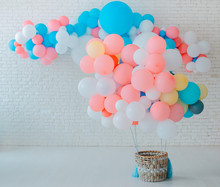 Balloons Basket For Air Flight On White Brick Background With Bright Blue Pink Background With Free Space