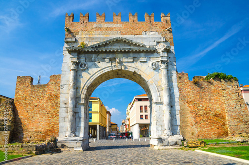 Ruins of ancient brick wall and stone gate Arch of Augustus Arco di Augusto and Canvas Print