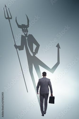 Fényképezés  Devil hiding in the businessman - alter ego concept