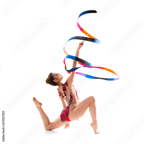 Girl doing rhythmic gymnastics with ribbon .