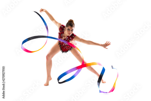 Girl doing rhythmic gymnastics with ribbon .