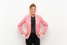 Young Blonde Woman With Pink Suit Posing With Arms At Hip And Smiling