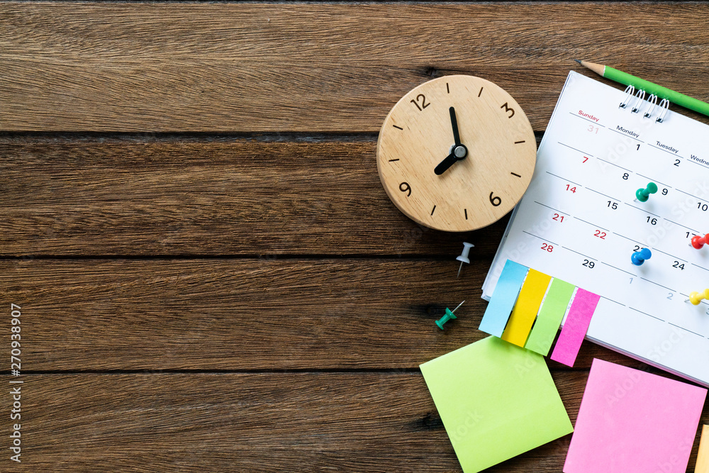 Fototapety, obrazy: close up of calendar and clock on the table, planning for business meeting or travel planning concept