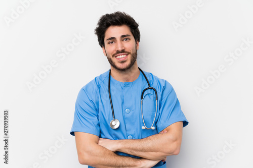 Fotografia  Surgeon doctor man over isolated white wall laughing