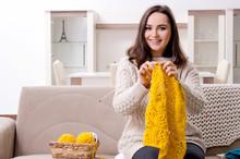 Young Beautiful Woman Knitting...