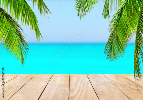 Poster Turquoise Wooden table top on blue sea and white sand beach