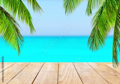 Foto auf Leinwand Turkis Wooden table top on blue sea and white sand beach