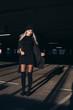 Leinwandbild Motiv Hip young woman in parking garage