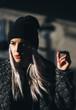Leinwandbild Motiv Hip young blond woman smoking