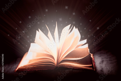 Fototapety, obrazy: open magic book, blue cool white light from a book, magic, true knowledge, light of science