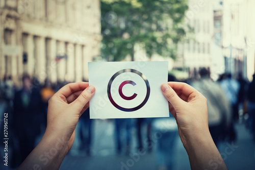 Hands hold paper with copyright symbol Canvas