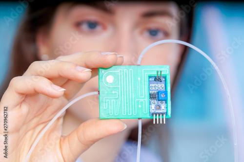 Obraz na plátně Girl holding polymers Bio-MEMS biomedical microelectromechanical systems / LOC l