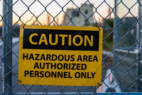 Caution sign for hazardous area on metal fence Fototapeta