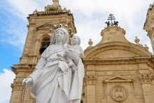 Statue Of The Virgin Mary With Child Jesus Outside The Parish Church In Xaghra, Gozo, Malta.