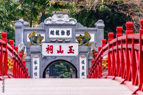 The iconic red painted Huc Bridge over Ho Hoan Kiem Lake, Hanoi, Vietnam which leads to the Den Ngoc Son Confucious Temple.