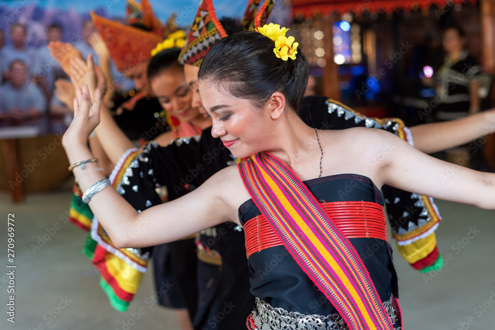 Fototapety, obrazy: Beautiful young girls from Kota Belud Kadazan Dusun ethnic performed traditional dance during state level Harvest Festival in KDCA, Kota Kinabalu, Sabah Malaysia.