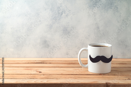 Poster Echelle de hauteur Happy Father's day concept with coffee mug and mustache over wooden background