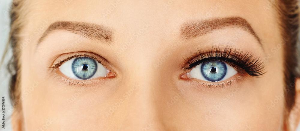 Fototapety, obrazy: Female eyes with long false eyelashes, befor and after change. Eyelash extensions, make-up, cosmetics, beauty
