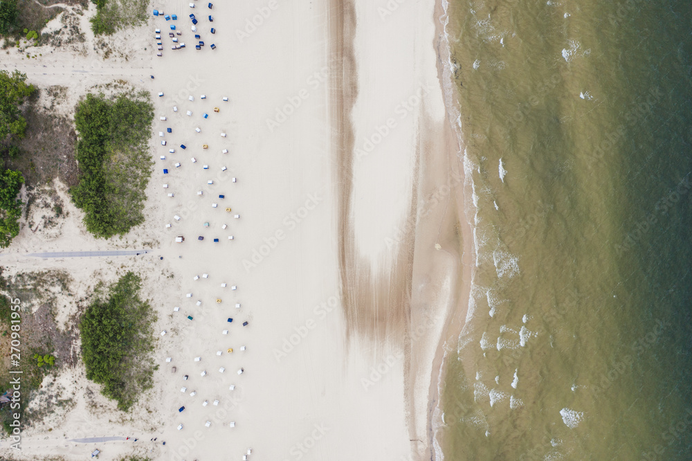 Fototapety, obrazy: Top down view of the sandy baltic sea beach with beach baskets.